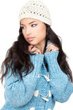 Young black hair woman in a blue wool sweater. Portrait of a young black hair woman in a blue wool sweater, isolated on white background Stock Image