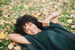 Autumn relax and happiness. Young black happy woman relaxing and doing thumbs up in autumn. Happiness and relax concept Royalty Free Stock Images