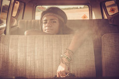 Young black hippie woman in a retro van.  Royalty Free Stock Images