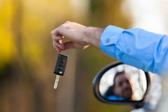 Young black latin american driver holding car keys driving his n Royalty Free Stock Images