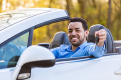 Young black latin american driver holding car keys driving his n Stock Photo