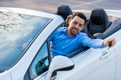 Young black latin american driver holding car keys driving his n Stock Photos