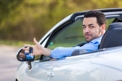 Young black latin american driver holding car keys driving his n Royalty Free Stock Photo
