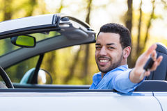 Young black latin american driver holding car keys driving his n Royalty Free Stock Photography
