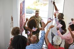 Young African American  male soldier returning home to his three generation family, elevated view, close up. Young black male soldier returning home to his three royalty free stock photos