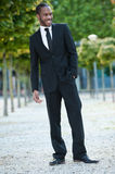 Young Black Male Standing Outside with a Smile Royalty Free Stock Image