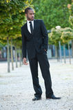 Young Black Male Staning in a Suit Outside Royalty Free Stock Images
