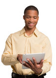 Young Black Male Texting on Touch Pad Isolated Royalty Free Stock Image