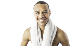 Young black male with towel. Isolated photo of a young african american black male holding a towel can be used for health, exercise or hygeine Stock Photography