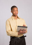 Young Black Male Writing on Notepad Royalty Free Stock Photography