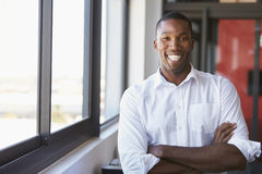 Young black man with arms crossed smiling, horizontal Stock Photo