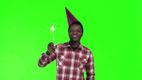 Young black man celebrating with a sparkler stock video