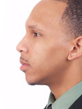 Young black man closeup profile portrait. Young African American man profile portrait in suit royalty free stock photos