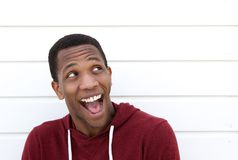 Young black man with funny expression. Close up portrait of a young black man with funny expression on face - posing on white background Royalty Free Stock Photography