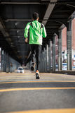 A young, black man goes for a jog in the streets of Brooklyn, NY. A young, black man goes for a run in the streets of Brooklyn, New York City. Shot during the Royalty Free Stock Images