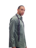 Young black man in green shirt tie undone Stock Photo