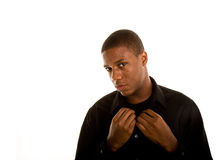 Young Black Man Hands on Collar Head to Side Royalty Free Stock Image