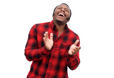 Young black man laughing and clapping hands Royalty Free Stock Photography