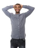 Young black man laughing with hands on head Royalty Free Stock Photos