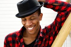 Young black man laughing outdoors Royalty Free Stock Photography