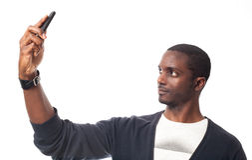 Young black man make a self portrait. Royalty Free Stock Photo