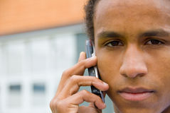 Young black man with mobile Royalty Free Stock Images