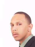 Young black man portrait in business suit. Green shirt Royalty Free Stock Photo