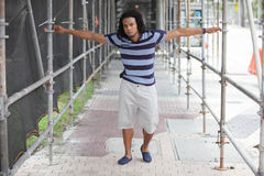 Young black man posing under scaffolding royalty free stock photos