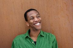 Young black man smiling outdoors Stock Photography