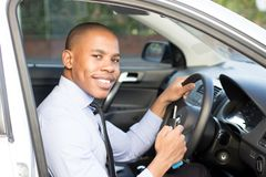 Young Black Man smiling while sitting in his car Royalty Free Stock Photo