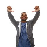 Young black man smiling with thumbs down gesture Stock Images