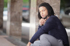 Young black man in a squatting pose Royalty Free Stock Photo