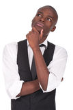 Young Black Man Standing And Thinking Stock Photos