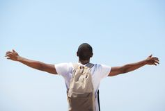 Young black man standing with arms outstretched Royalty Free Stock Photography
