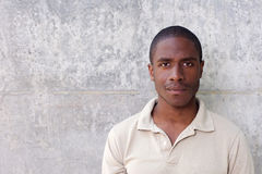 Young black man staring. Close up portrait of young black man staring Stock Image