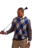 Young black man in sweater with golf club Stock Images