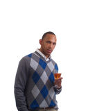 Young black man in sweater with wine glass Stock Image