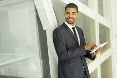 Young black man with tablet in office Stock Images