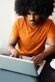 Young black man using laptop computer Stock Photo