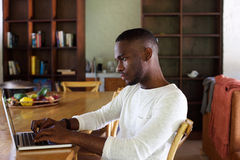 Young black man using laptop computer Royalty Free Stock Photography