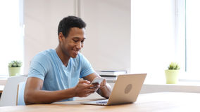 Young Black Man Using Smartphone, Online Browsing Royalty Free Stock Image