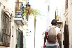 Young black man waking in town with bag Royalty Free Stock Photos