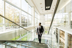 Young black man walking in office Royalty Free Stock Photo