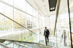 Young black man walking in office Stock Image