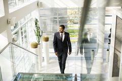 Young black man walking in the office Royalty Free Stock Photography
