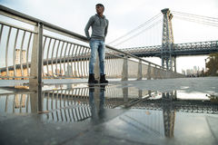 A young, black man walks along NYC`s East River - Autumn 2016 Royalty Free Stock Image