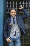Young Black Man with wrought iron fence royalty free stock photos