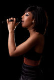Young black singer performing at concert Stock Photo