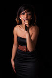 Young black singer performing at concert Royalty Free Stock Image