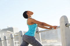 Young black sports woman exercise stretching outside. Portrait of young black sports woman exercise stretching outside Royalty Free Stock Photos